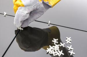 tegelkruizen vloertegels leggen tegelzetter contact